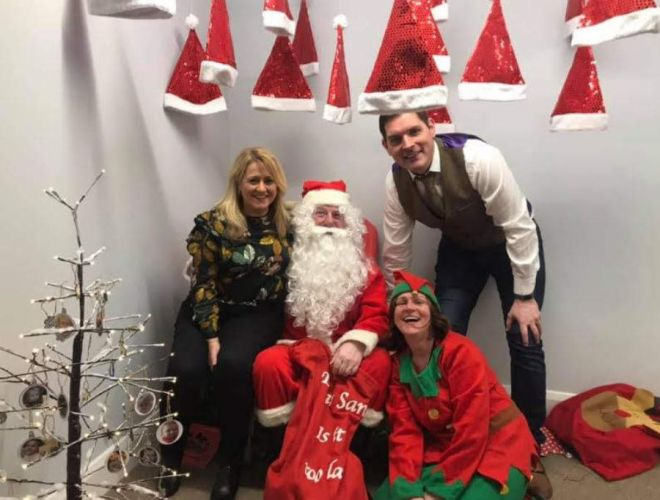 Angela Reid, Santa, Malachi and Jackie the Elf